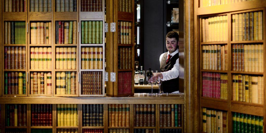 Secret Door Faux Books False Books on bar front DecBOOKS Decora Mouldings